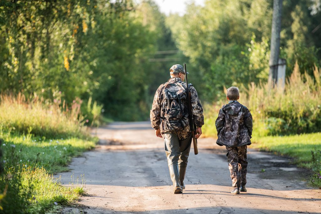father and son on safe deer hunt
